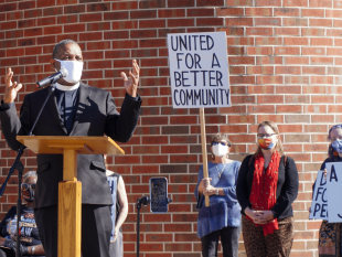 Rev. Dr. Timothy Tyler speaking in front of a crowd